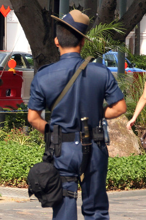 backcarry view of Singapore Gurkha soldier carrying a Kukri